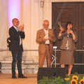 I genitori Isa Liantonio e Francesco Bari  con  Don Vito Zinfollino e assessore Facciolongo